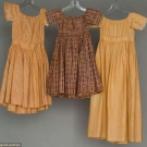 THREE TODLERS' CALICO DRESSES, 1830-1850