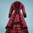 GARNET POLONAISE VISITING DRESS, LATE 1860s
