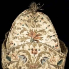 GENT'S EMBROIDERED GOLD & SILK AT-HOME CAP, 1700-1750
