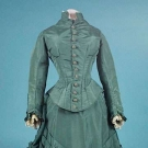 SAGE GREEN SILK VISITING DRESS, EARLY 1880s