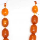12 LARGE EGG YOLK AMBER BEADS, CHINA OR TIBET