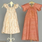 TWO INFANTS' CALICO DRESSES, 1805-1820