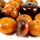 ANTIQUE EGG YOLK AMBER BEADS, CHINA or TIBET
